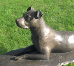 LYING STAFFIE SCULPTURE