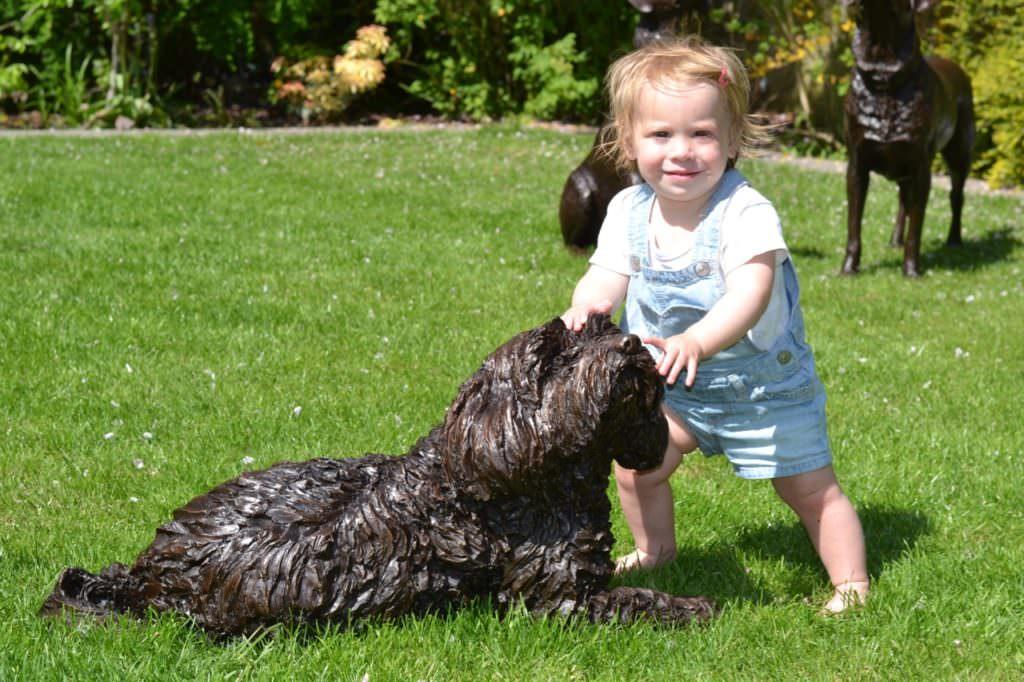 Tibetan Terrier sculpture and child