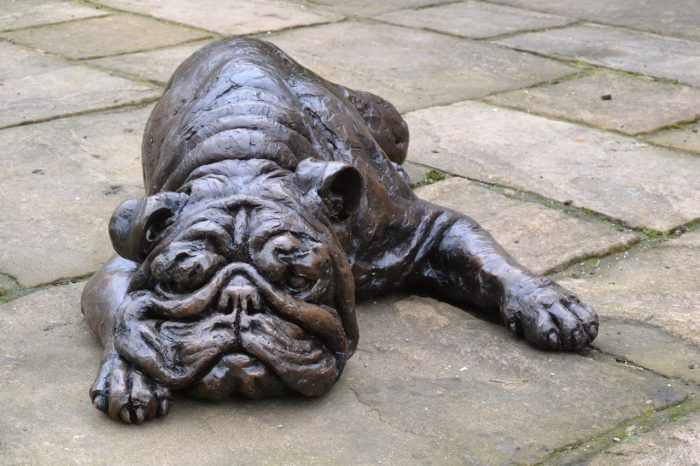 LYING ENGLISH BULLDOG SCULPTURE