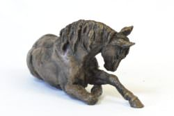 Resting horse sculpture front quarter right view