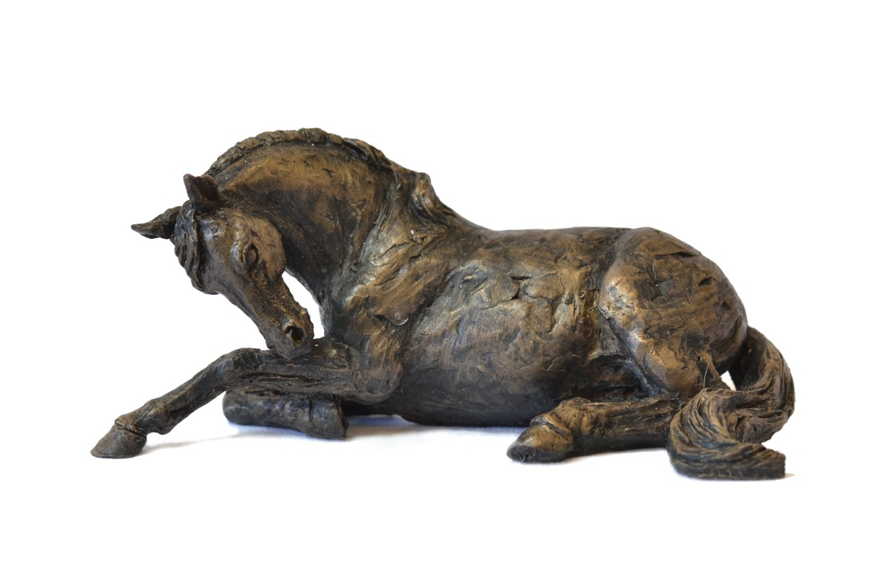 bronze resting horse sculpture by animal sculptor tanya