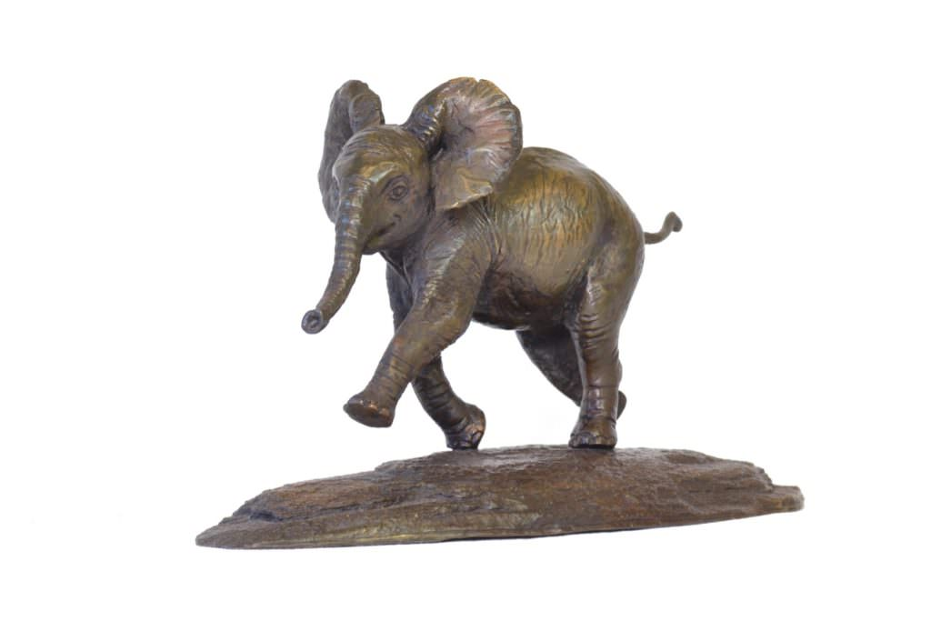 Quarter left side view of Baby Elephant sculpture by Tanya Russell in foundry bronze