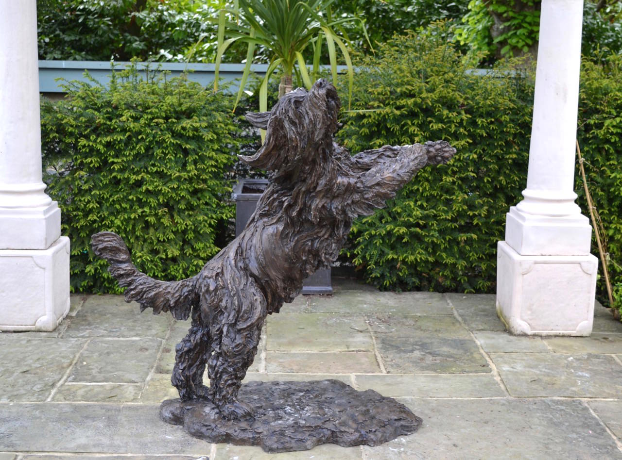 Playing Bearded Collie sculpture