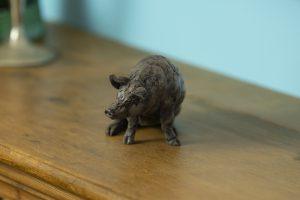 pig ornament in bronze