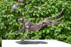 Running Cheetah sculpture in foundry bronze left side view