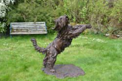 LEAPING BEARDED COLLIE SCULPTURE