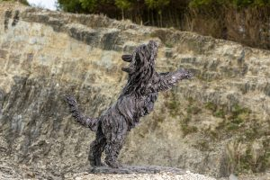 bronze bearded collie sculpture