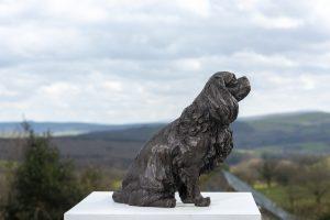 sitting cavalier king charles bronze statue
