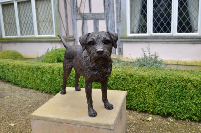 Border Terrier Standing Bronze Sculpture image, dog statue sculpted by Tanya Russell, front view