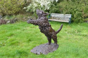 bronze leaping border collie sculpture
