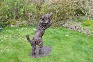 bronze leaping bearded collie statue