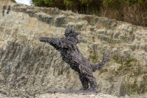 bronze bearded collie statue