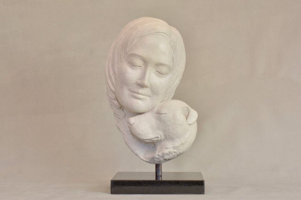 girl and dog sculpture