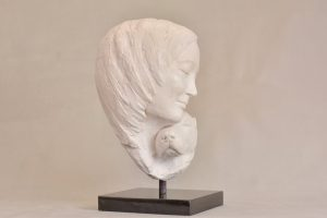 Woman and dog sculpture