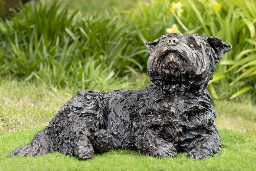 Lying yorkshire terrier sculpture