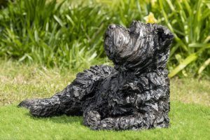 lying yorkshire terrier statue