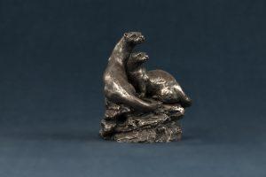 bronze otter pair