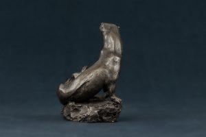 bronze otter and cub statue