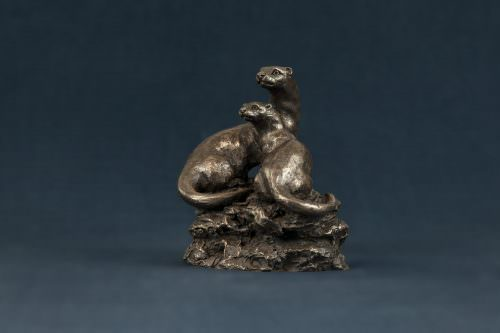 PAIR OF OTTERS SCULPTURE
