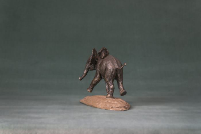 PLAYING BABY ELEPHANT SCULPTURE