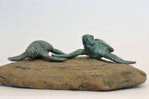 pair of turtles sculpture