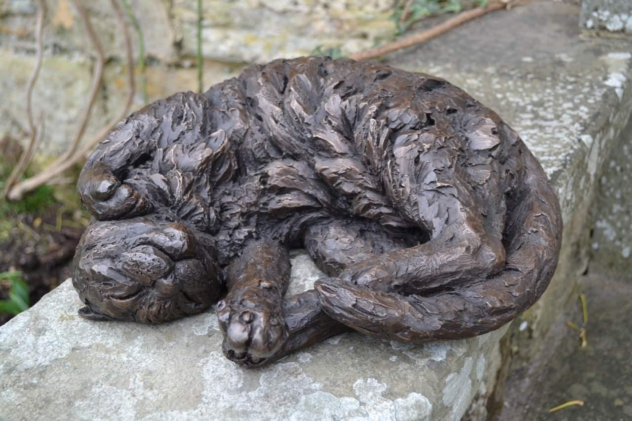 CURLED CAT SCULPTURE