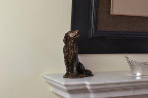 golden retriever sculpture in bronze