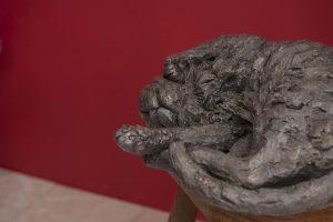 bronze cat statue on chair