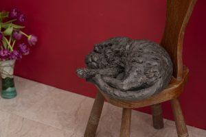 bronze cat statue indoors