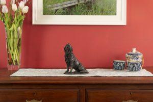 retriever ornament on mantelpiece