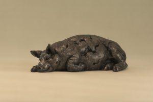 sleeping pig statue
