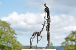 Woman and Fawn Outdoor Statue