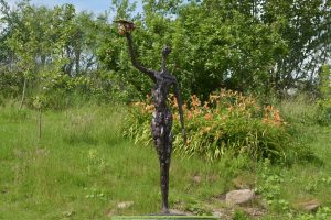 bronze woman and bee statue