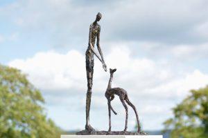 Woman and Fawn Garden Sculpture