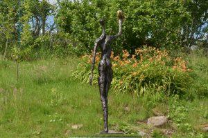figure and bee sculpture