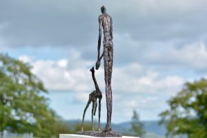 Woman and Fawn Outdoor Trust Statue