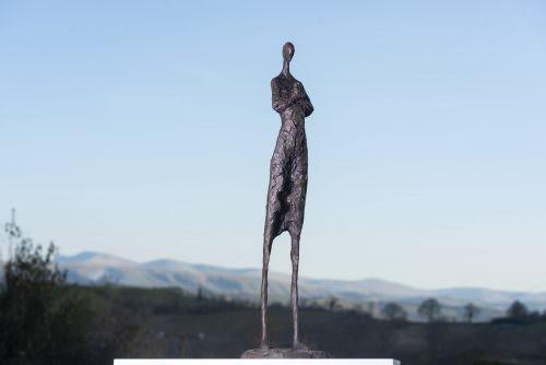 'TENDERNESS' WOMAN AND BIRD SCULPTURE