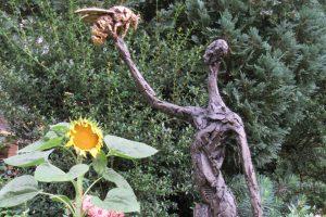 woman and bee bronze sculpture