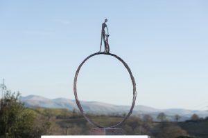 Bronze Man and Dog Garden Ring Sculpture