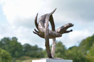 'THROUGH CLEAR WATER' OTTERS SWIMMING THROUGH RING SCULPTURE