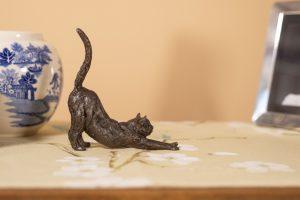 STRETCHING CAT SCULPTURE