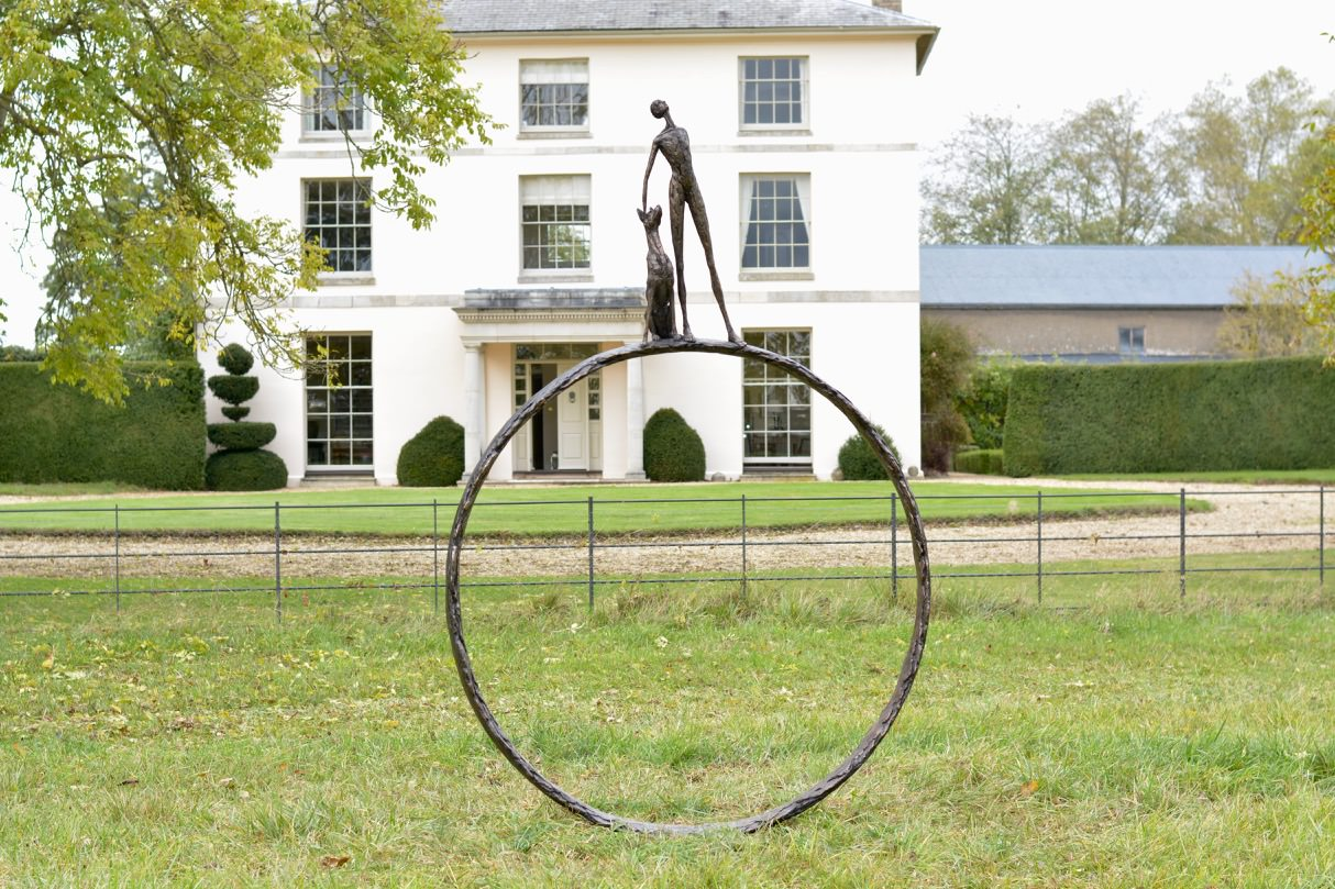 'LARGE STARGAZERS' MAN AND DOG ON RING SCULPTURE