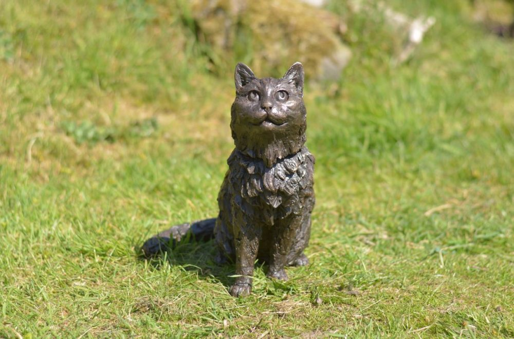 sitting longhaired cat statue