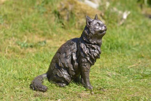 sitting longhaired cat sculpture
