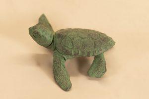 Bronze baby turtle raising its head sculpture